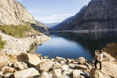 Caucasian man photographing lake in Yosemite National Park, California, United Kuvituskuvat