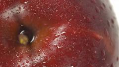 Close-up of a delicious red apple sprinkled with water rotating - stock footage