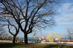 Beautiful panorama of colourful Odessa sea port cranes ,view from park,Ukraine - stock photo