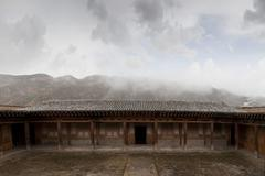 Remote monastery and cloudy sky, Qinghai, Tibet, China Stock Photos