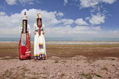 Rear view of women in traditional clothing in remote landscape Stock Photos