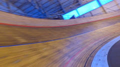 4K Action tracking shot going around racing track in velodrome. No people.  Stock Footage