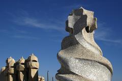 Face shaped chimneys on Gaudi Casa Pedrera Stock Photos