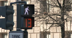 Crosswalk signal in downtown of city going from walk to the red hand 4k Stock Footage