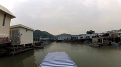 Stock Video Footage of View to the Tai O fishermen village from the tourist boat in Hong Kong, China.