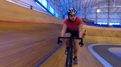 4K Action tracking shot of competitive cyclists racing on track in velodrome - stock footage