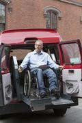 Caucasian man in wheelchair in accessible van - stock photo