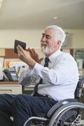 Caucasian businessman using digital tablet in office Stock Photos