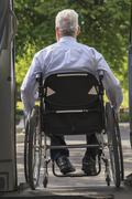 Caucasian businessman in wheelchair exiting van Stock Photos