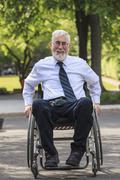 Caucasian businessman in wheelchair outdoors Stock Photos