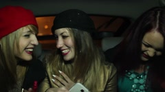 Chicks talking, laughing and making a selfie in the back of a cab - stock footage
