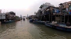 View to the Tai O fishermen village from the tourist boat in Hong Kong, China. - stock footage