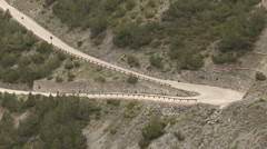 Two cyclists climb of the Stelvio Stock Footage