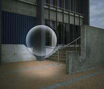 Sphere floating over city stairs Stock Photos