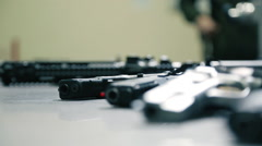 Pistols with Collars lie on a Steel Table Stock Footage