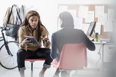 Business people talking in office Kuvituskuvat