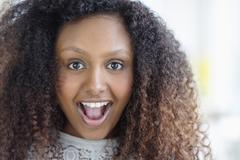 Black woman gasping - stock photo