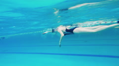 Rapid swimming in the pool shooting underwater Stock Footage