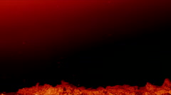 Red glowing ground and ash particles floating slowly on black background Stock Footage