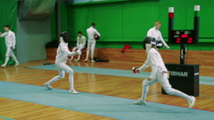 Fencing. Two fencer train in the hall swords Stock Footage
