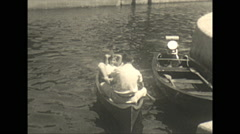 Vintage 16mm film, 1934, Ontario, Kawartha Lakes paddling canoe Stock Footage