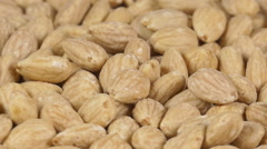 Close-up of almonds on a rotating plate Stock Footage