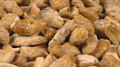 Close-up of mixed nuts on a rotating plate Stock Footage