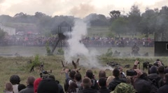 Spectators watch the reconstruction of military action Stock Footage