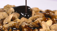 Pouring delicious chocolate syrup over mixed nuts Stock Footage