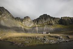 Rocky cliffs in remote field Stock Photos
