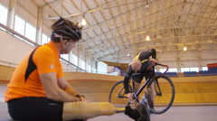 4K 2 Competitive cyclists, 1 with prosthetic leg, prepare for training session - stock footage