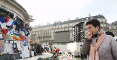 Stock Video Footage of Woman crying Place de la Republique monument , Paris, France