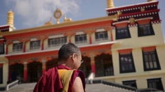 Happy old Buddhist Monk walking to new temple Stock Footage