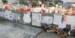 Zoom out from candles, shoes and messages at Place de la Republique monument , Stock Footage
