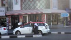 Arab Taximan cleaning his cab. Entering into the car. Stock Footage