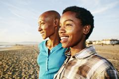 Black women smiling on beach Stock Photos