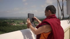 Buddhist Monk takes photo with ipad Stock Footage