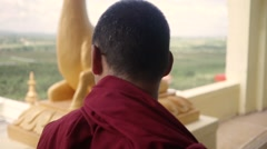 Buddhist Monk looking far Stock Footage