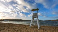 4k timelapse of lake shore with lifeguard hut on beach Stock Footage