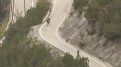 Some bikers explore  climb the Stelvio Stock Footage