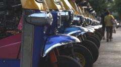 Tuk Tuk parked on street - stock footage