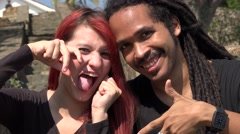 Happy Female Redhead Teen And African Man Posing Stock Footage