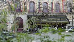 Bataclan Theatre Parisseen through trees Stock Footage