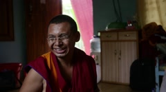 Happy Buddhist Monk smiling in his room Stock Footage