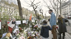 Family paying tribute Bataclan Theatre Paris - stock footage