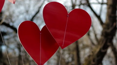 Two hearts hanging Stock Footage