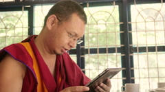 Happy Buddhist Monk with tablet Stock Footage