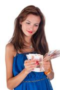 Young smiling woman with freckles holds cash Stock Photos