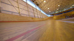 4K Competitive cyclists racing on track in velodrome Stock Footage