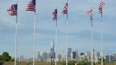 Manhattan Skyline from Liberty Park with USA Flags Stock Footage